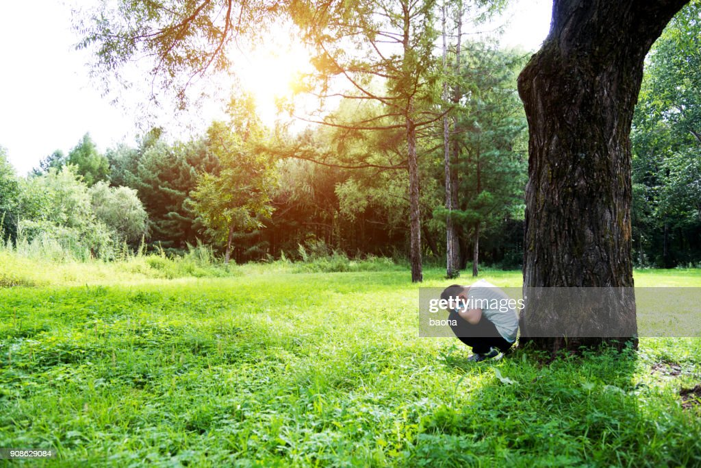 Sad boy under the tree : Stock Photo