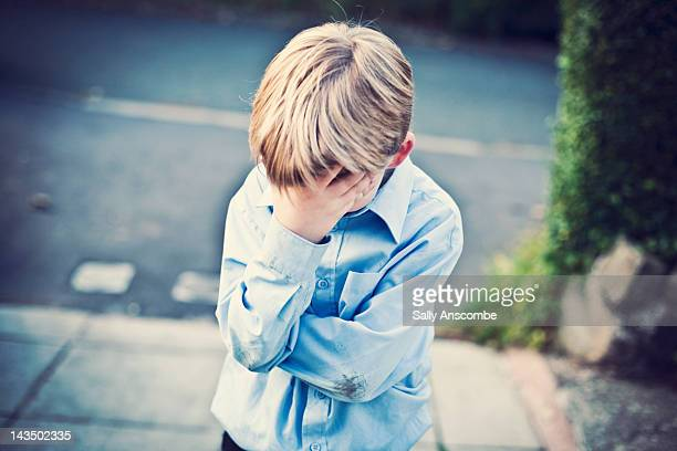 sad boy with his head in hand - disappointment stock pictures, royalty-free photos & images