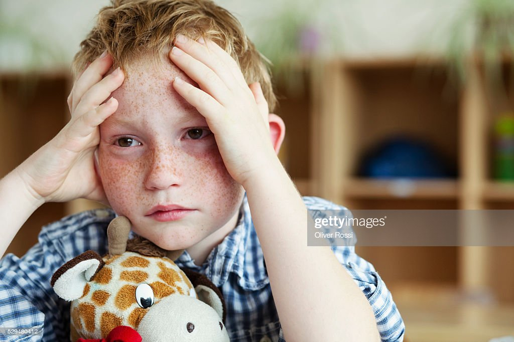 Sad boy with stuffed animal : Stock Photo