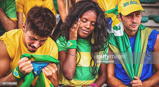 Sad brazilian supporters at stadium