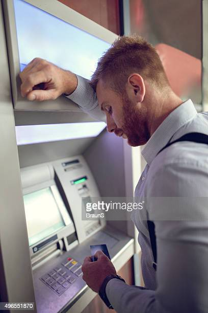 sad businessman doesn't have enough money on his credit card. - ginger banks stock pictures, royalty-free photos & images