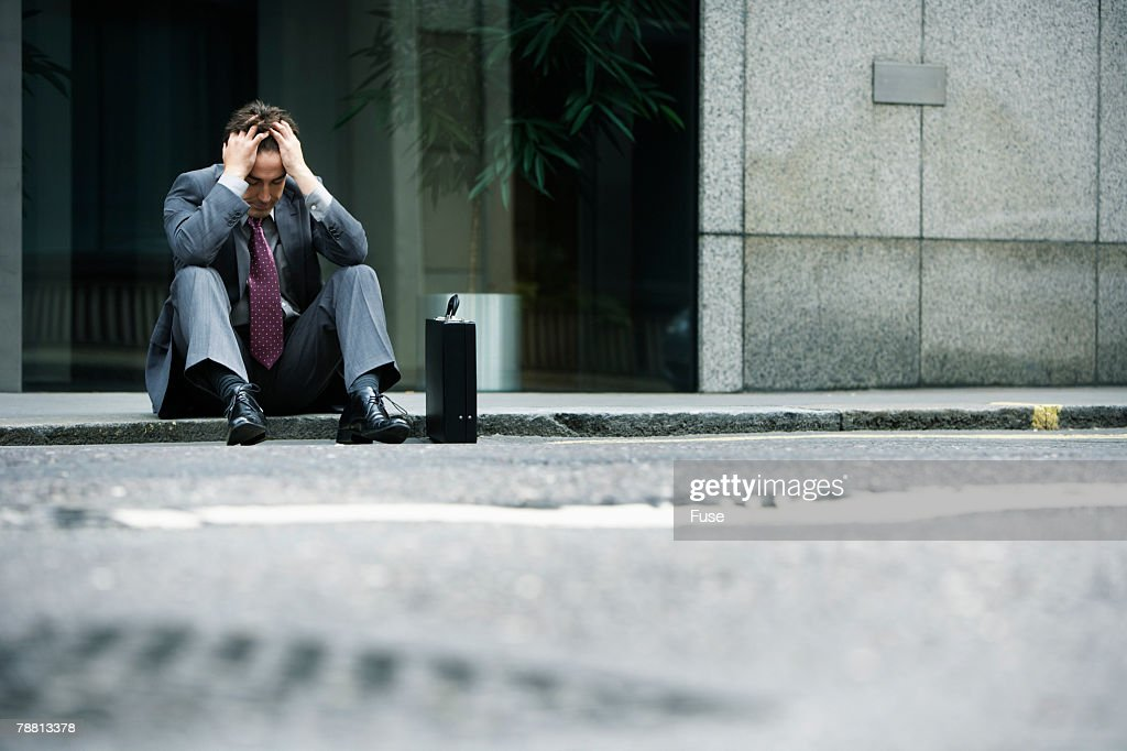 Sad Businessman Sitting on Kerb Outside Office Building : Stock Photo