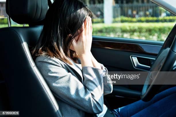 Sad businesswoman driver sitting in car