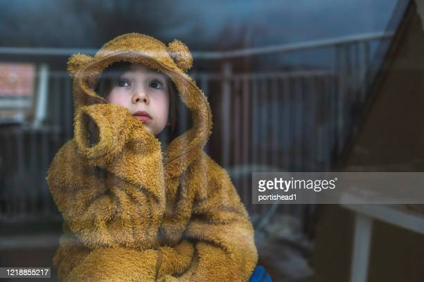 sad child in isolation at home - sadness stock pictures, royalty-free photos & images