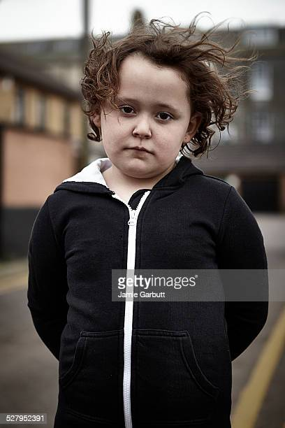 sad child looking directly into the camera - sad child stock pictures, royalty-free photos & images