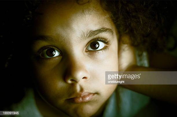 sad child (5-6) portrait looking upwards - onebluelight stock pictures, royalty-free photos & images