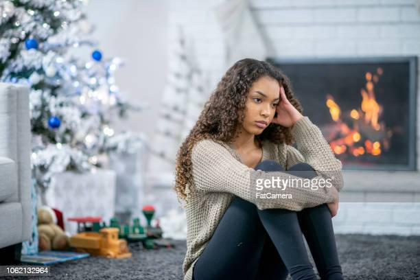 sad christmas girl - holiday stress stock pictures, royalty-free photos & images
