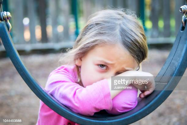 sad crying little girl - harassment stock pictures, royalty-free photos & images