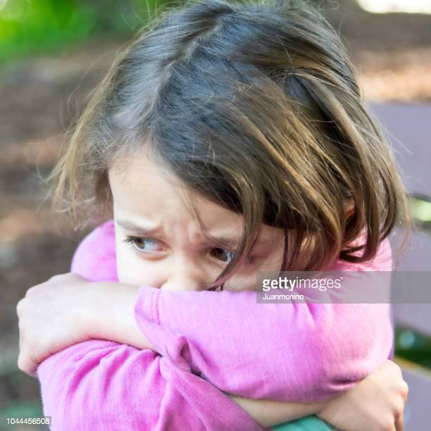 sad crying little girl - autism spectrum disorder stock photos and pictures