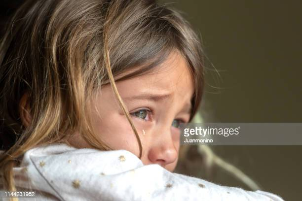 sad crying little girl - sadness stock pictures, royalty-free photos & images