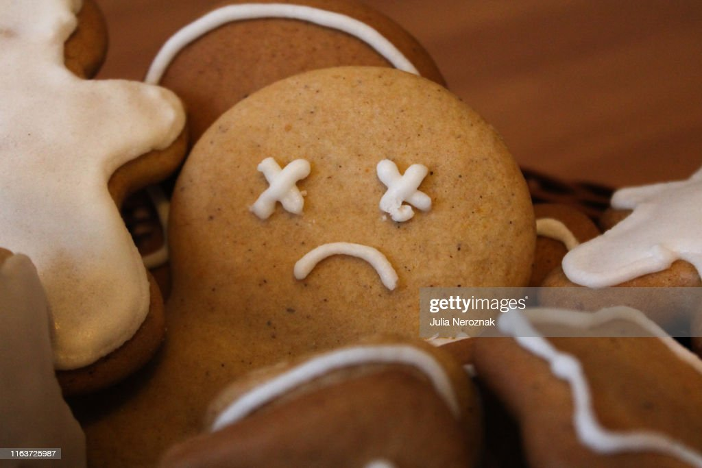 Sad gingerbread man in the woven basket : Stock Photo