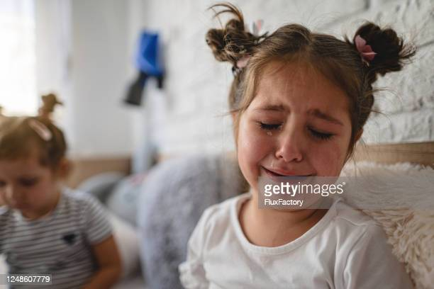 sad girl crying in her room - sister stock pictures, royalty-free photos & images