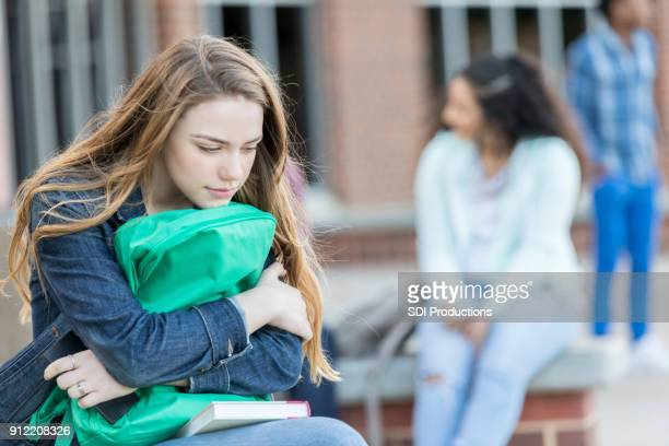 sad girl dreads the first day of school - teenagers only stock pictures, royalty-free photos & images