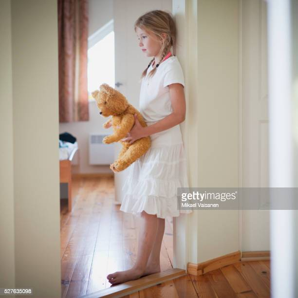 sad girl (7-9) embracing teddy bear - sadgirl stock pictures, royalty-free photos & images