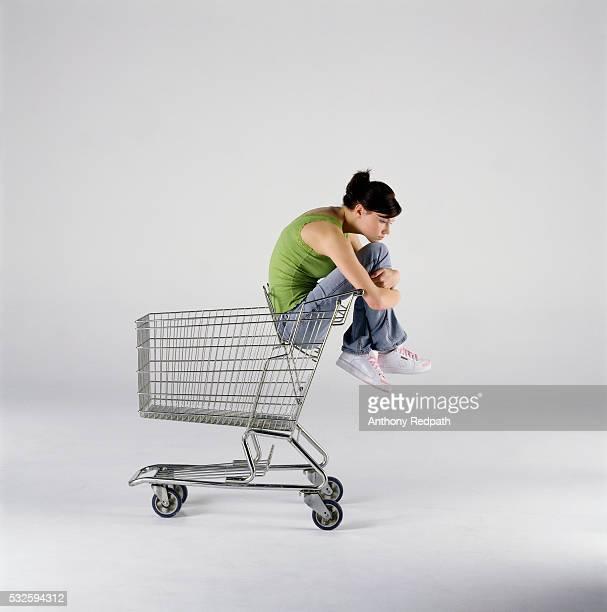 Sad Girl Sitting in Shopping Cart