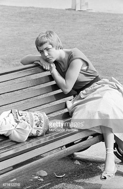 'A sad girl sitting on a bench The city houses the Geneva Summit discussing issues about security German reunification and disarmament Geneva 18th...