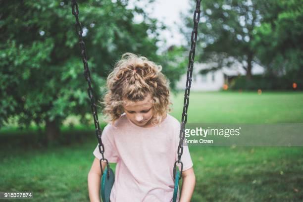 Sad Girl Sitting on Swing