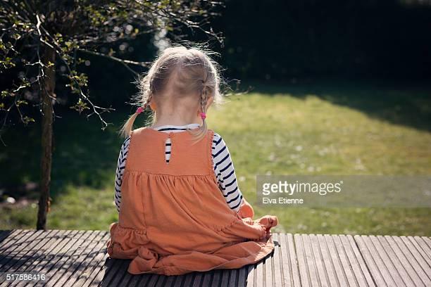 Sad girl sitting with head down