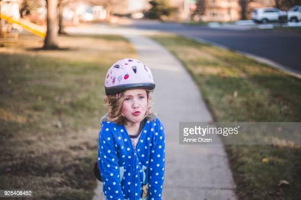 Sad Girl wearing helmet