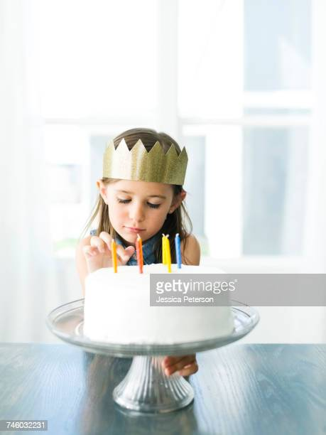 sad girl (6-7) with birthday cake - sadgirl stock pictures, royalty-free photos & images