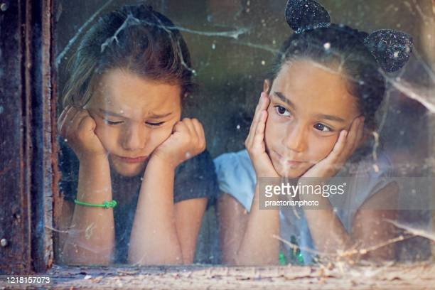 sad girls are looking trough the window - losing virginity stock pictures, royalty-free photos & images