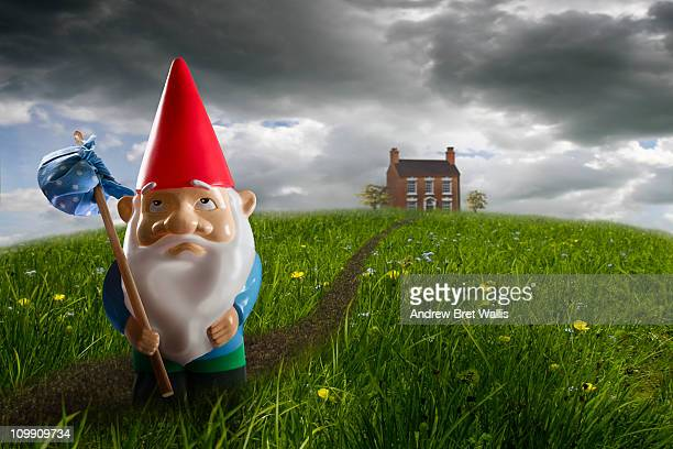 sad gnome leaving his home behind
