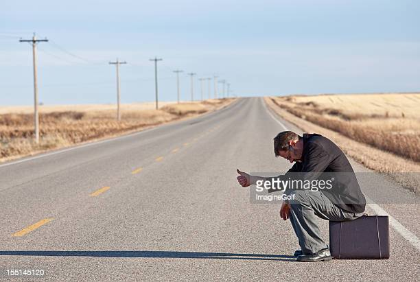 Sad Hitchhiking Businessman