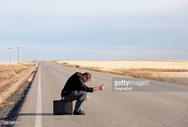 Uomo d'affari triste Fare l'autostop