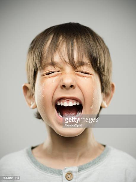 sad little boy crying loudly - shouting stock photos and pictures