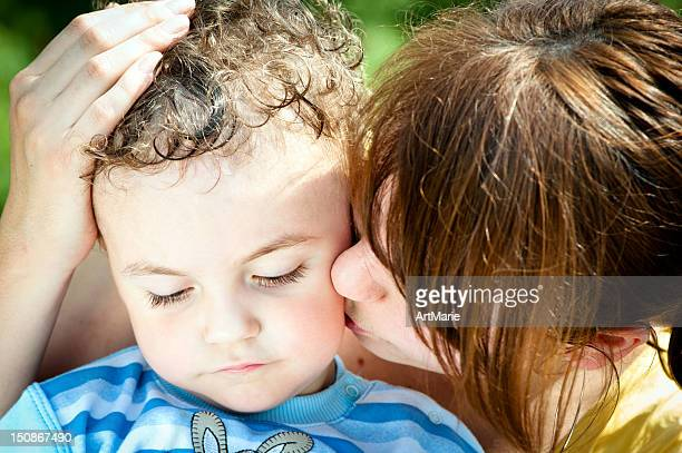 sad little boy - sheltering stock pictures, royalty-free photos & images