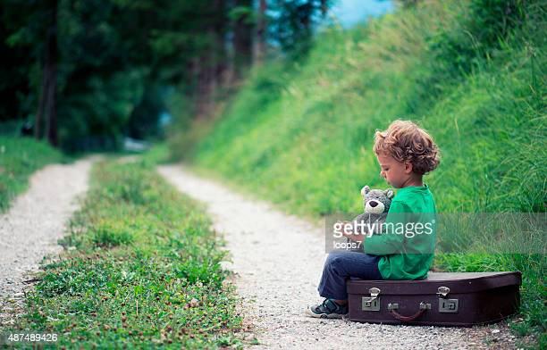 Sad Little Boy Traveling