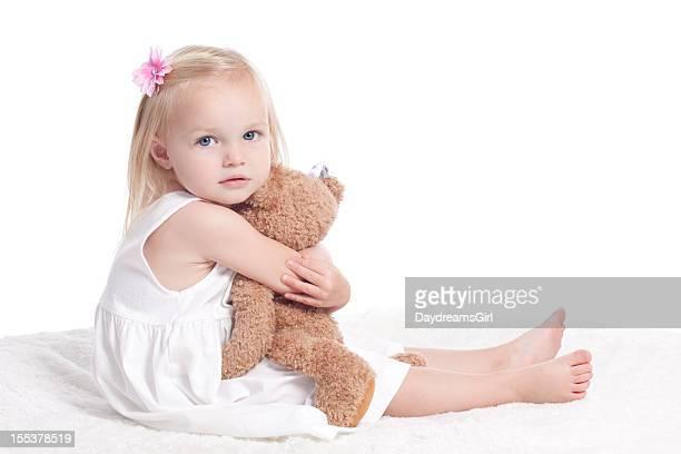 Sad Little Girl in White Dress Hugging Stuffed Animal