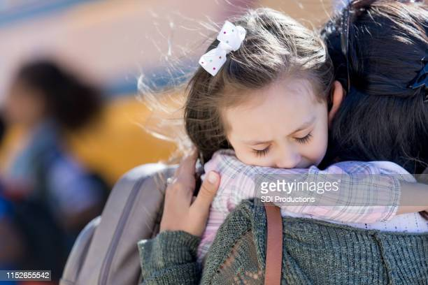 sad little girl is apprehensive about the first day of school - first day of school stock pictures, royalty-free photos & images