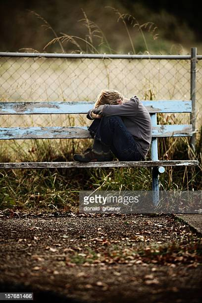 sad lonely boy - fetal position stock photos and pictures