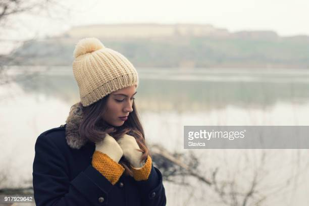sad lonely woman outdoor in winter - beige hat stock photos and pictures