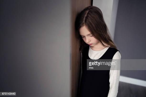 sad looking girl - bestrafung stock-fotos und bilder