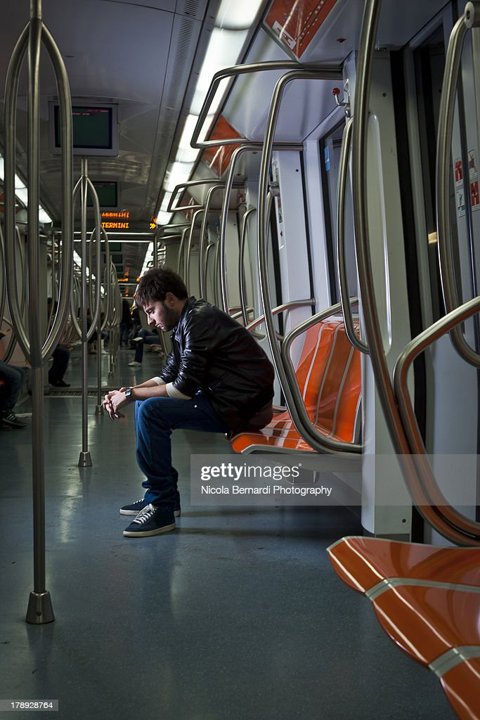 Sad looking guy in the subway : Stock Photo