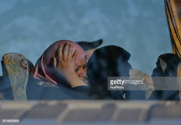 A sad migrant sitting in the bus that will leave the temporary transfer camp in Opatovac near border crossing point between Serbia and Croatia in...