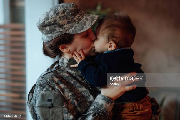 Sad military soldier says goodbye to her son