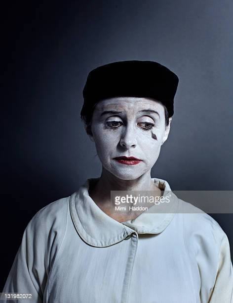 sad mime artist with dramatic lighting - mime stock photos and pictures