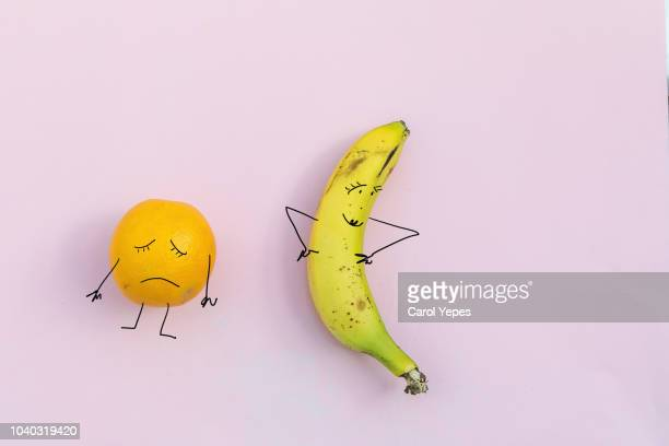 sad orange and happy banana.diet  concept - grasa nutriente fotografías e imágenes de stock