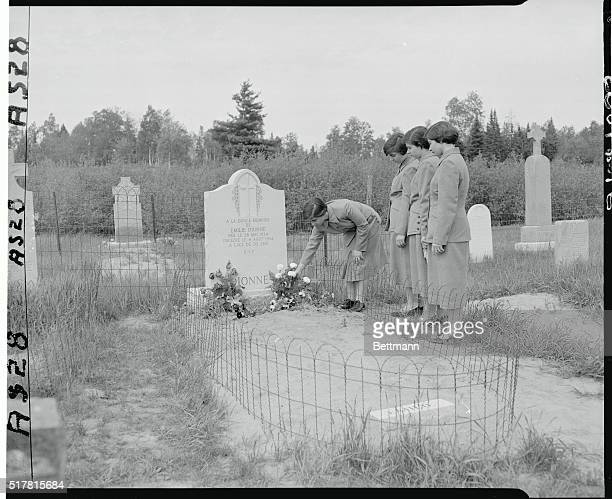 Sad Pilgrimage to Emilie's Grave on 21st Birthday Corbeil Ontario The four surviving Dionne quintuplets who reunited at their home to observe their...
