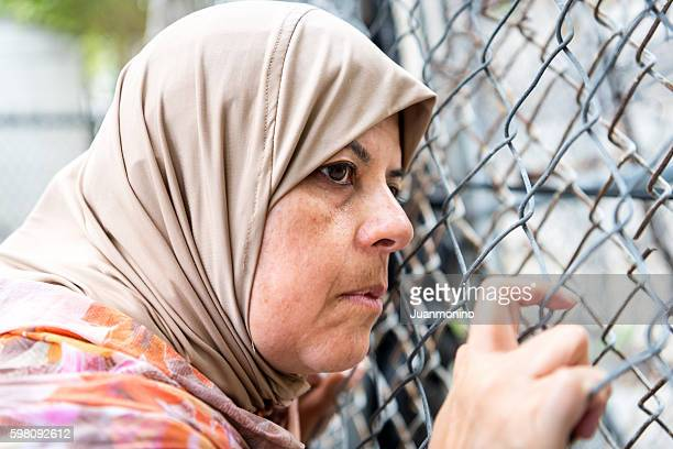 sad refugee middle eastern woman (real people) - syrian culture stock photos and pictures