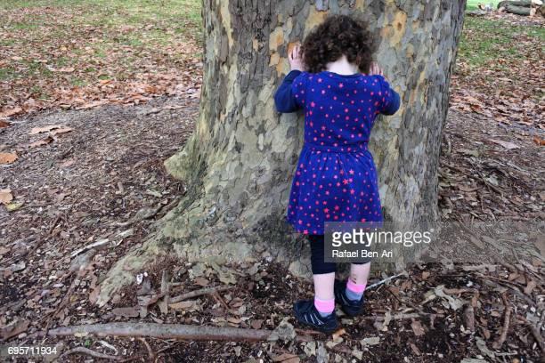 sad small girl crys outdoors - rafael ben ari stock-fotos und bilder