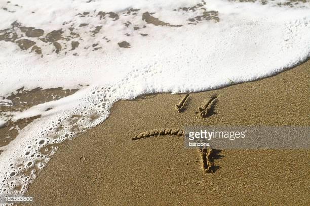 Triste sourire sur la plage