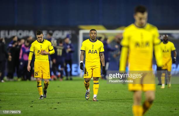 Sad Steven Bergwijn and Giovani Lo Celso of Tottenham Hotspur leave the field after losing the UEFA Europa League Round of 16 Second Leg match...