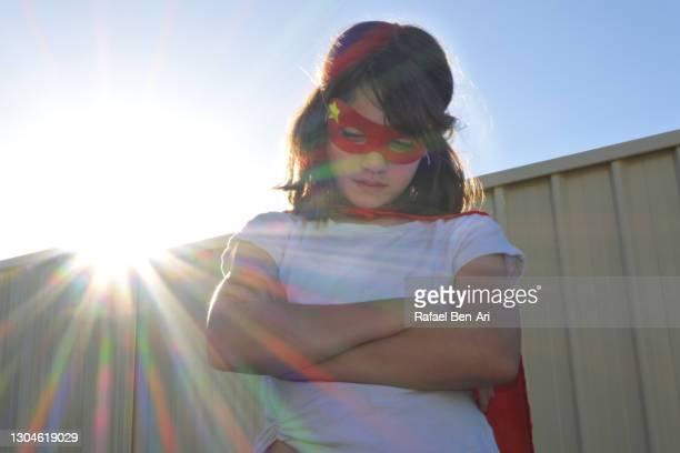 sad superhero girl crossed arms looking down - rafael ben ari imagens e fotografias de stock