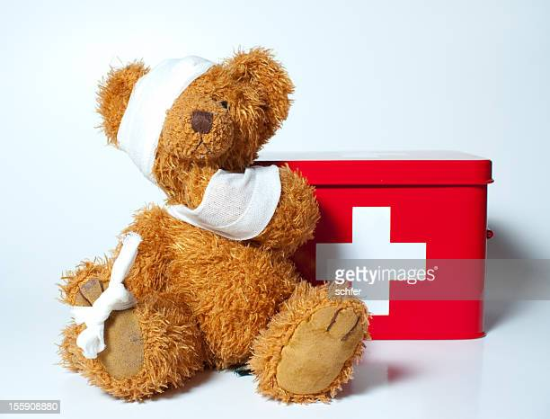 sad teddybear - first aid kit stock pictures, royalty-free photos & images