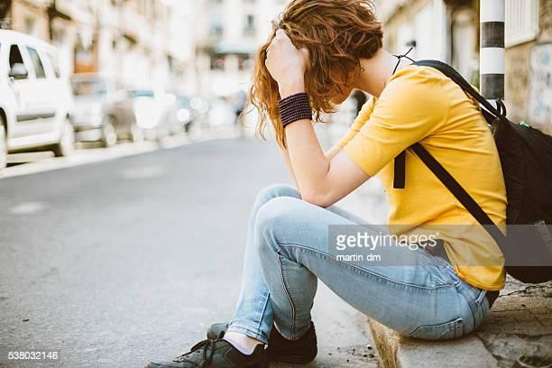 Sad teenage girl at the street