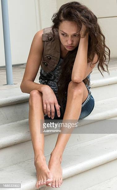 sad teenage girl sitting on outdoor steps - underweight stock photos and pictures